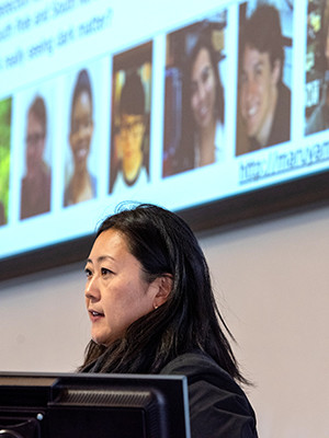 "Yale physicist Reina Maruyama presents on ""Detecting Dark Matter."" (Photo credit: Mara Lavitt)"
