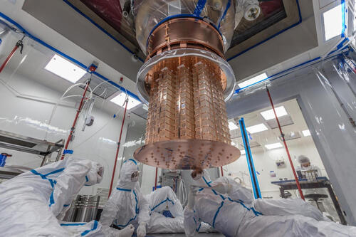 Researchers work on the assembly of the CUORE experiment before it begins taking data. (Credit: CUORE Collaboration)