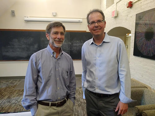 """Paul Tipton, outgoing chair, with Karsten Heeger, incoming chair, at the Department of Physics' annual """"Tea Time and Awards Celebration,"""" held on Friday, May 17, 2019 in the Sloane Physics Laboratory. Photo credit: Yale Wright Laboratory/Victoria Misenti"""