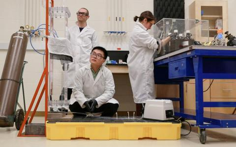 Tom Langford, Ke Han, and Danielle Norcini (left to right) filling the PROSPECT20 liquid scintillator neutrino detector in the new labspace in Wright Laboratory. (photo by Ke Han)