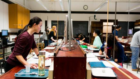 Undergraduate students in the 165 lab during their final exam. Photo by Christian Weber