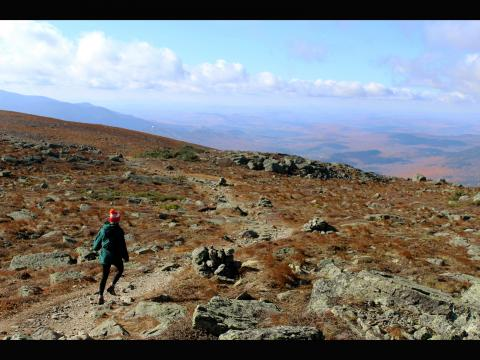 Connor Hann. Physics grad student Kelly Backes hikes the white mountains.