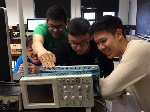 Four undergraduates practicing for the PHYS 166 practical exam. Photo by Sidney Cahn