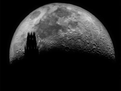 Hao Yan. Moonrise behind Yale Harkness Tower. Shot by 650mm Newtonian telescope.