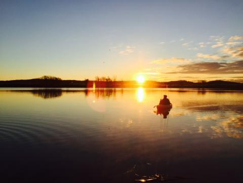 Picture of Daliang Li kayak fishing on Quinnipiac river of new haven. Taken by Jun Wang
