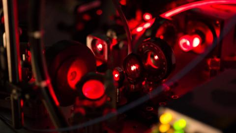 Optics used in laser cooling and magneto-optical trapping of strontium monofluoride. The first laser cooling and magneto-optical trapping of a molecule were achieved at Yale. Photo by Matt Steinecker