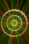 "Relativistic Heavy Ion Collider (RHIC). The white points show ""hits"" recorded by particles emerging from the collision as they strike sensors in three layers of the HFT. Scientists use the hits to reconstruct charged particle tracks (red and green lines) to measure the relative abundance of certain kinds of particles emerging from the collision—in this case, charmed lambda particles. (Image courtesy of STAR Collaboration)"