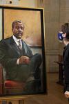(c) Yale News. Asher Liftin '21 admiring the new portrait of Edward Bouchet. (Photos: Jessica Smolinski)