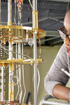 Former Yale postdoc Danielle Speller, who is now an assistant professor at Johns Hopkins University, documents the process of detector assembly. (Credit: Yale Wright Laboratory/Sid Cahn)